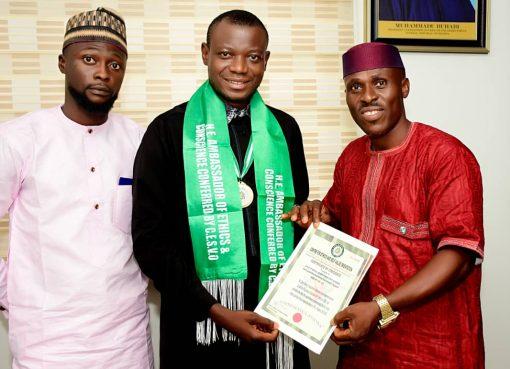 Hon. Abdulkareem Onyekehi Suleiman, in the middle receiving the Award